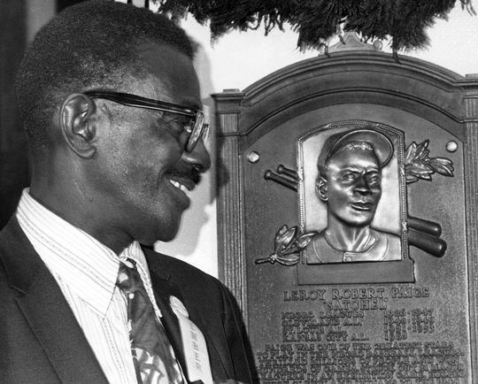 Satchel Paige admires his Hall of Fame plaque on Aug. 9, 1971, in Cooperstown. Paige was the first player elected by the Committee on Negro Baseball Leagues. (National Baseball Hall of Fame and Museum)
