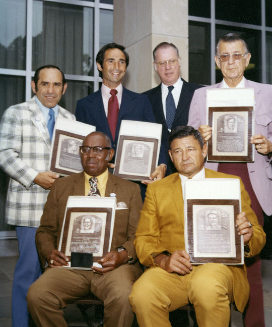 Clockwise, from top left: Hall of Fame inductees Yogi Berra, Sandy Koufax, Commissioner Bowie Kuhn, inductees Lefty Gomez, Early Wynn and Buck Leonard at the 1972 Hall of Fame Induction Ceremony. (National Baseball Hall of Fame Library)