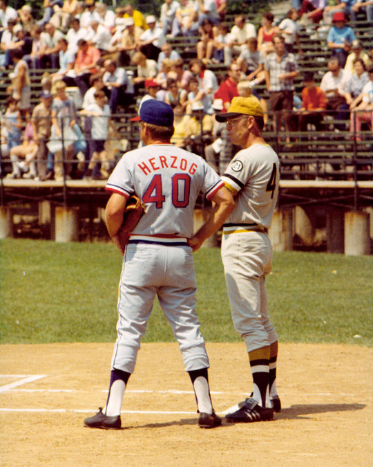 White Herzog stands near home plate with a Pittsburgh Pirate. BL-365.81 (National Baseball Hall of Fame Library)