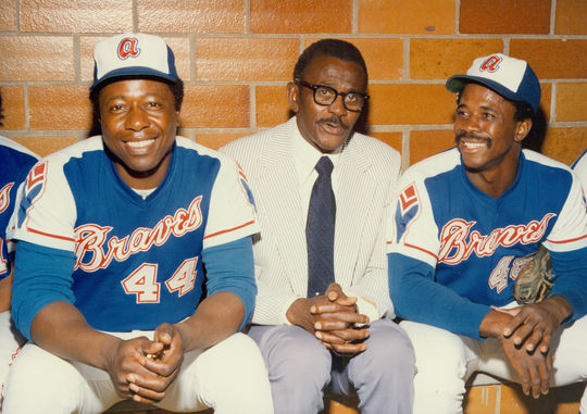 Ralph Garr, far right, with Hank Aaron and Satchel Paige in the Braves dugout. (National Baseball Hall of Fame Library)
