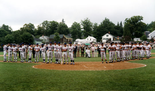 The teams line up along the first and third base lines before the game. (National Baseball Hall of Fame Library)