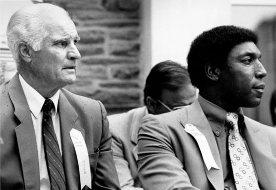 Hall of Fame inductees Bobby Doerr and Willie McCovey sit on the stage during the 1986 Hall of Fame Induction Ceremony in Cooperstown. BL-7953-94 (Tom Ryder / National Baseball Hall of Fame Library)