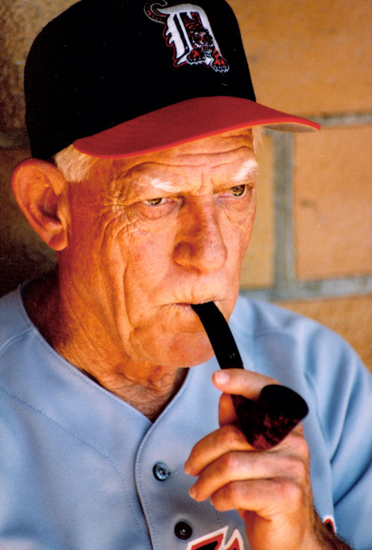 Detroit Tigers manager, and Hall of Famer, Sparky Anderson smoking his pipe in the dugout at Doubleday Field during the 1995 Hall of Fame Weekend. (Milo Stewart, Jr. / National Baseball Hall of Fame)