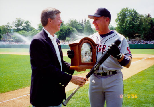 Don Marr presenting bat and clock to Jack Howell as winner of home run hitting contest. BL-5665.96 (Frank Vitagliano / National Baseball Hall of Fame Library)
