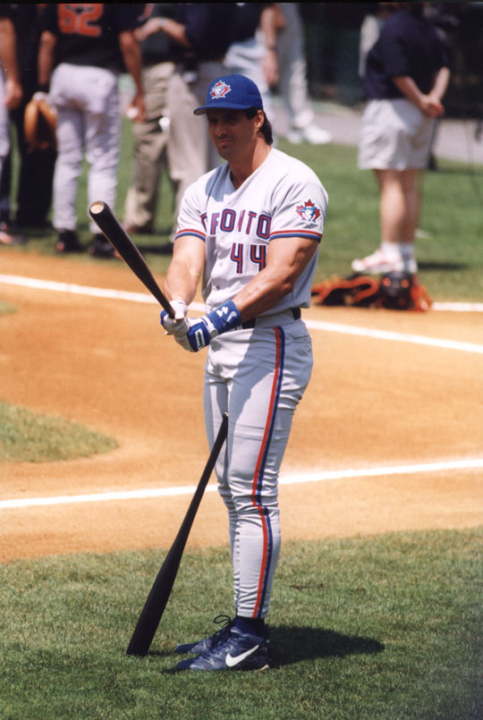 Jose Canseco of the Toronto Blue Jays choosing a bat to use during the Hall of Fame Game. (Tom Ryder, National Baseball Hall of Fame)