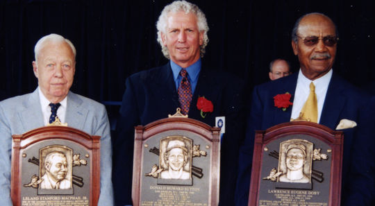 """From left, Lee MacPhail, Don Sutton and Larry Doby - the living members of the Class of 1998 - were inducted on July 26 of that year along with George Davis and """"Bullet"""" Joe Rogan. (Milo Stewart Jr./National Baseball Hall of Fame and Museum)"""