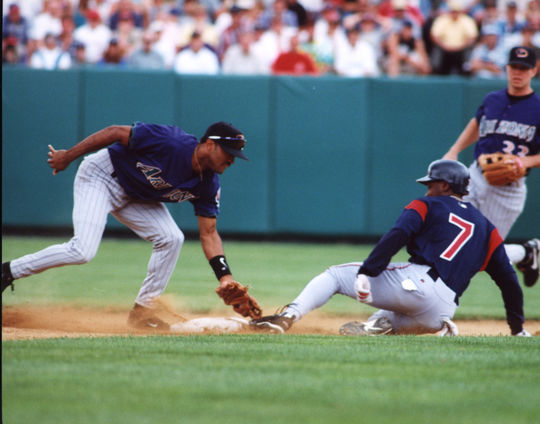 Indians outfielder Kenny Lofton slides into second base as a Diamondback makes the tag. (Tom Ryder / National Baseball Hall of Fame)