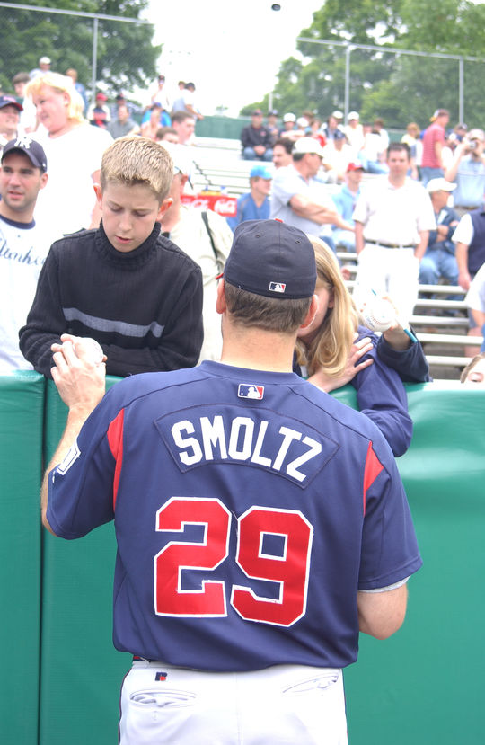 Future Hall of Famer John Smoltz signing a baseball for a young fan. (Milo Stewart, Jr. / National Baseball Hall of Fame Library)