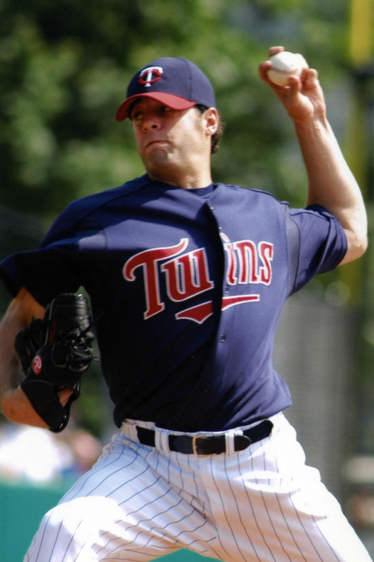 A Twins pitcher delivering a pitch during the 2004 HOF Game. BL-2064.2004.14 (National Baseball Hall of Fame Library)