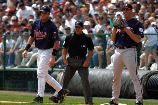 The Atlanta Braves first baseman keeps an eye on the Twins base runner. BL-2064.2004.26 (National Baseball Hall of Fame Library)