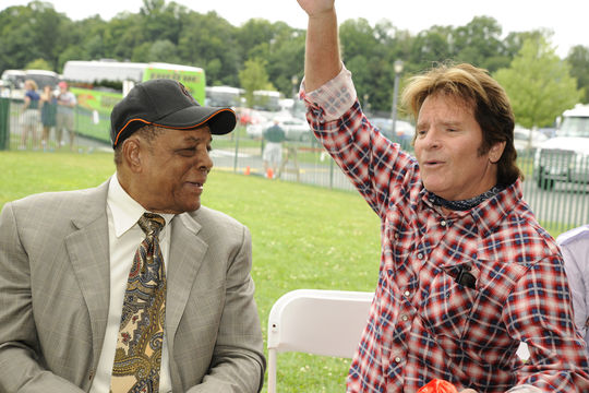 Hall of Famer Willie Mays talks with rock singer John Fogerty during the 2010 Hall of Fame Weekend in Cooperstown. (National Baseball Hall of Fame Library)