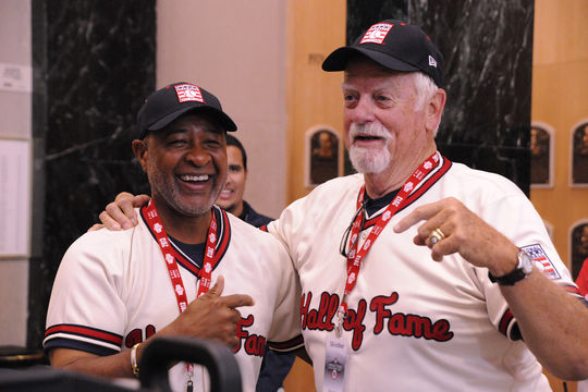 Hall of Famers Ozzie Smith and Gaylord Perry share a laugh in the PLAY Ball event during the 2013 Hall of Fame Weekend. (Milo Stewart, Jr. / National Baseball Hall of Fame)