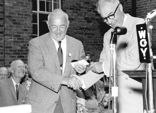 Frank Frisch accepts his Hall of Fame pin from Commissioner Ford C. Frick. (National Baseball Hall of Fame Library)