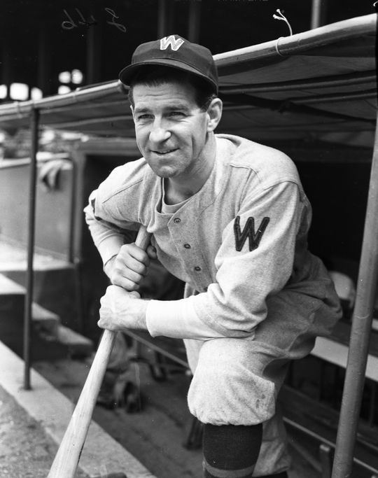 Hall of Famer Bucky Harris was manager for the Washington Senators in 1954, when Carlos Paula was a rookie in camp and when he later made his Major League debut.  Harris-Bucky-250-71b_FL_NBL  (National Baseball Hall of Fame)
