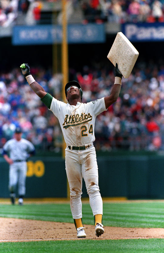 Rickey Henderson holds up stolen base number 939, making him the all-time stolen base leader on May 1, 1991. (Brad Mangin /  National Baseball Hall of Fame Library)