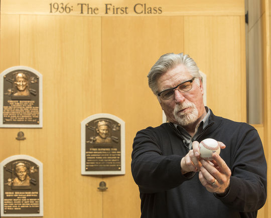 Jack Morris shows off his pitching grip in the Museum's <em>Plaque Gallery</em> during his Orientation Visit. (Milo Stewart Jr./National Baseball Hall of Fame and Museum)
