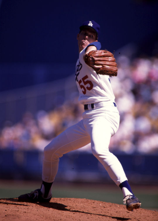 Los Angeles Dodgers pitcher Orel Hershiser broke the all-time consecutive scoreless innings mark -- set by another Dodger, Hall of Famer Don Drysdale -- by throwing 59 scoreless frames during the stretch run of the 1988 season. Hershiser would win a National League Cy Young Award, a Gold Glove Award, NLCS MVP and World Series MVP honors during the 1988 campaign. BL-635-95 (John Cordes / National Baseball Hall of Fame Library)