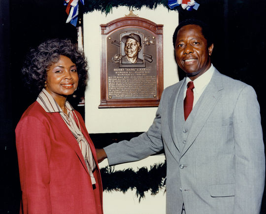 Hank and Billye Aaron pose for a photo with Hank's Hall of Fame plaque during his 1982 Induction Ceremony in Cooperstown. BL-1973-83 (National Baseball Hall of Fame Library)