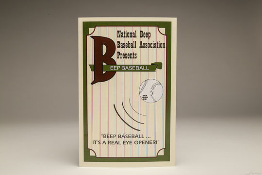 The cover of the National Beep Baseball Association's rule book. The league uses baseballs with an implanted beeping device to help visually impaired players hit and track the ball. (Parker Fish / National Baseball Hall of Fame)
