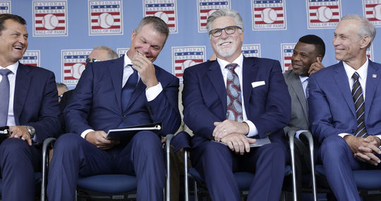 Class of 2018 members (from left) Trevor Hoffman, Chipper Jones, Jack Morris and Alan Trammell share a light moment during the July 29 <em>Induction Ceremony</em> in Cooperstown. (Milo Stewart Jr./National Baseball Hall of Fame and Museum)
