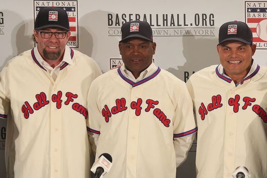 Jeff Bagwell (left), Tim Raines (center) and Iván Rodríguez (right) don their Hall of Fame jerseys and caps for the first time, during a press conference in New York City. (Jean Fruth / National Baseball Hall of Fame)