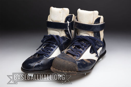 Jodi Haller wore these cleats when she pitched for Meiji University in Tokyo. (Milo Stewart Jr./National Baseball Hall of Fame and Museum)