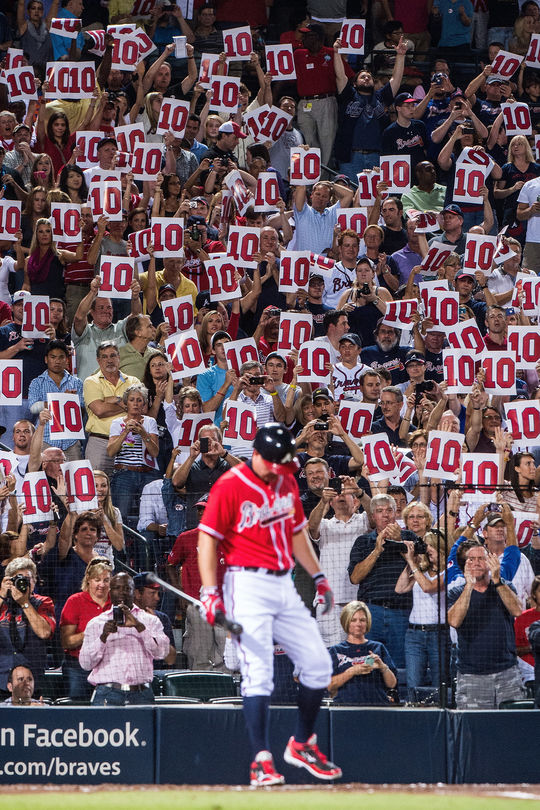 Atlanta Braves fans hold signs for Chipper Jones, No. 10 of the Atlanta Braves, as he bats against the New York Mets in his final series at Turner Field, on Sept. 28, 2012. (Pouya Dianat / Atlanta Braves)