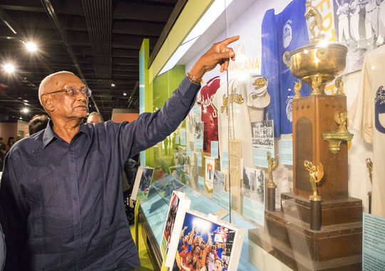Justino Clemente enjoys a tour of the Hall of Fame on Sept 29, 2018, including a stop at the Museum's Viva Baseball exhibit, which is dedicated to the Latin American baseball experience. (Milo Stewart Jr./National Baseball Hall of Fame and Museum)