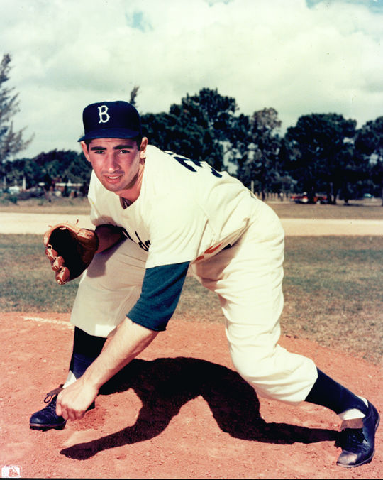 Sandy Koufax posing for a photograph in his Brookyln Dodgers uniform. BL-730.97 (Photo File / National Baseball Hall of Fame Library)