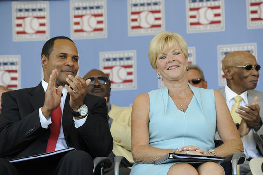 Class of 2012 inductee Barry Larkin and Vicki Santo, widow of inductee Ron Santo, take part in the Induction Ceremony festivities on July 22, 2012. (Milo Stewart , Jr. / National Baseball Hall of Fame)
