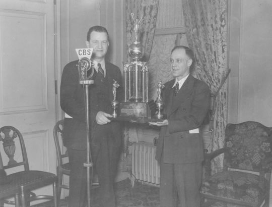 France Laux, left, receives an award for announcing from Edgar Brand. BL-975.86 (National Baseball Hall of Fame Library)