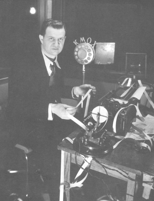France Laux sitting behind his desk. He was the first full-time radio voice of baseball in the St. Louis. (National Baseball Hall of Fame Library)