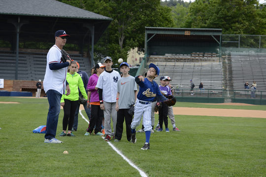 A group of youngsters get a head start on their careers with former Braves pitcher Steve Avery during the 2015 Cooperstown Skills Clinic at Doubleday Field. (Milo Stewart, Jr. / National Baseball Hall of Fame)