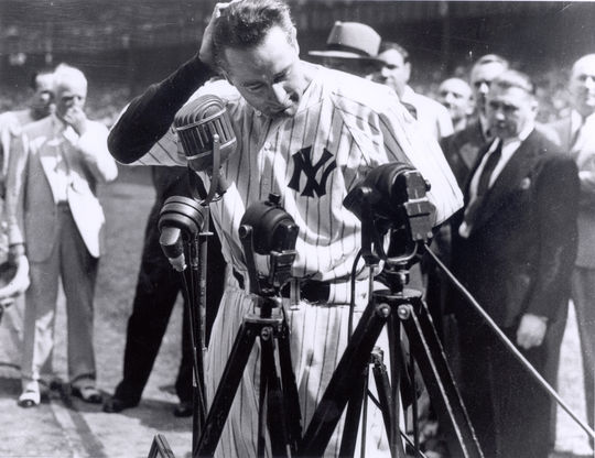 """New York Yankees first baseman Lou Gehrig announces his retirement during his famous """"Luckiest Man"""" speech on July 4, 1939 at Yankee Stadium. Gehrig passed away nearly two years later from amyotrophic lateral sclerosis. He was voted to the Hall of Fame by special election in 1939. BL-2830-98 (National Baseball Hall of Fame Library)"""