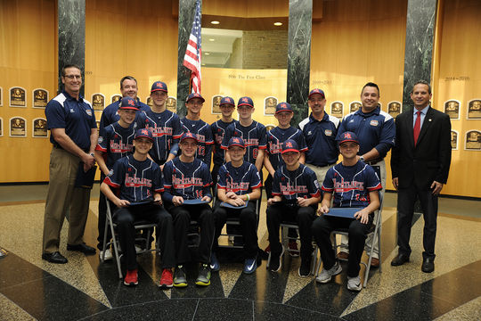 The Maine-Endwell Little League team poses with National Baseball Hall of Fame President Jeff Idelson, in the Plaque Gallery. (Milo Stewart Jr. / National Baseball Hall of Fame)