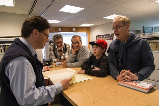 Television producer Mark Frost, right, learns about the Hall of Fame's Library archive with Senior Curator Tom Shieber as Frost's son Travis and his lawyer, Alan S. Wertheimer second from left, look on during a June 29 tour in Cooperstown. (Parker Fish / National Baseball Hall of Fame)