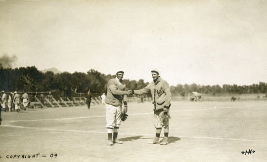 Hall of Fame pitchers Rube Waddell, then with the St. Louis Browns, and Christy Mathewson make up for lost time with a handshake in 1909. Despite leading the American League with 27 wins in 1905, Waddell missed a potential World Series showdown with Mathewson after injuring his left shoulder during the final month of the season. BL-255-76 (National Baseball Hall of Fame Library)