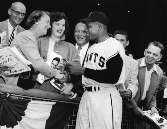 Willie May signing autographs during the 1954 World Series. (Osvaldo Salas Collection / National Baseball Hall of Fame Library)