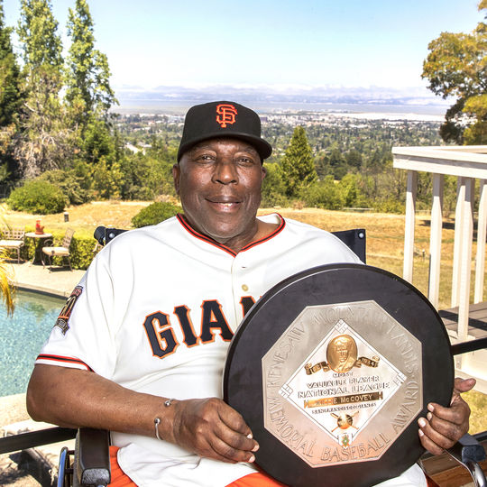 Willie McCovey holds his 1969 National League Most Valuable Player Award trophy at his home. McCovey passed away on Oct. 31, 2018. (Jean Fruth/National Baseball Hall of Fame and Museum)
