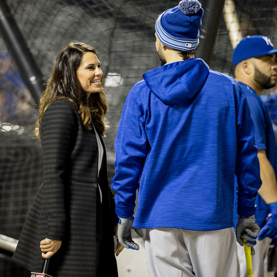 Jessica Mendoza, the first female Major League Baseball game analyst in the history of ESPN, chats with first baseman Eric Hosmer of the Kansas City Royals during batting practice before Game 5 of the 2015 World Series on Nov. 1, 2015 at Citi Field. (Jean Fruth / National Baseball Hall of Fame)