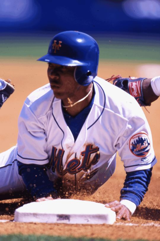 Melvin Mora of the New York Mets sliding into base. (Rich Pilling / National Baseball Hall of Fame)