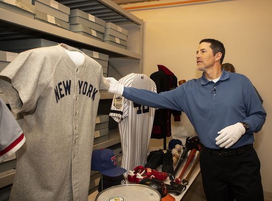 Mike Mussina admires items in the collection during his Orientation Visit in March, 2019. (Milo Stewart Jr./National Baseball Hall of Fame and Museum)