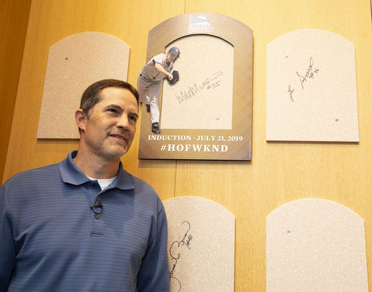 Mike Mussina poses with his signed plaque backer during his Orientation Visit. (Milo Stewart Jr./National Baseball Hall of Fame and Museum)
