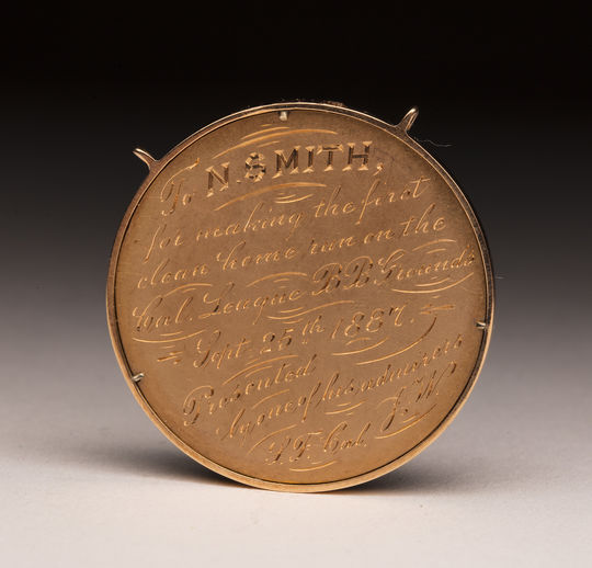 A gold medal presented to Nick Smith for a home run on Sept. 25, 1887. (Milo Stewart Jr./National Baseball Hall of Fame and Museum)