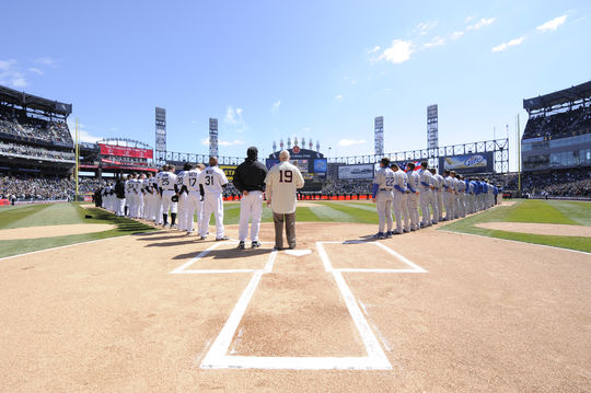 The Chicago White Sox and the Kansas City Royals stand for the National Anthem prior to facing off in the White Sox's 2009 home opener. (Ron Vesely/National Baseball Hall of Fame and Museum)