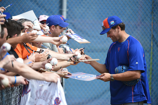 Mike Piazza signs autographs for fans in Port St. Lucie, Fla., this spring as an instructor with the Mets. Piazza's father, Vince, helped Piazza develop his talent at a young age and instilled in him a belief in his talent. (Mark Levine/ New York Mets)