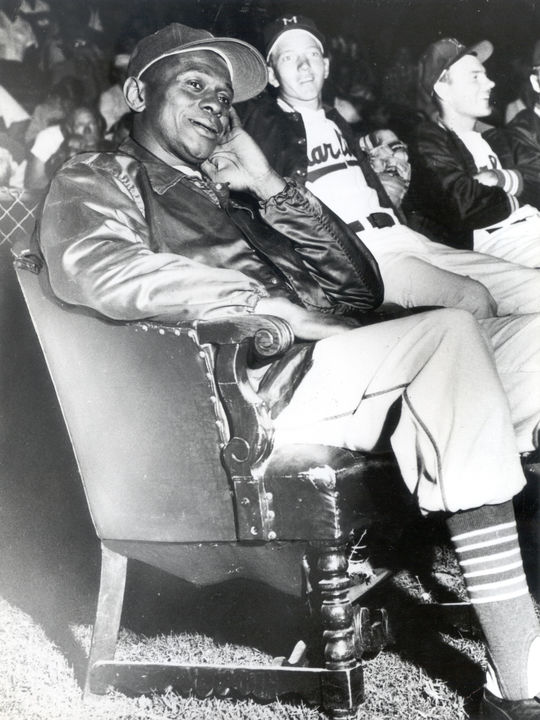 Satchel Paige relaxes in a special chair while playing with the Triple-A Miami Marlins. Paige pitched with Miami from 1956-58. BL-1843-63e (National Baseball Hall of Fame Library)