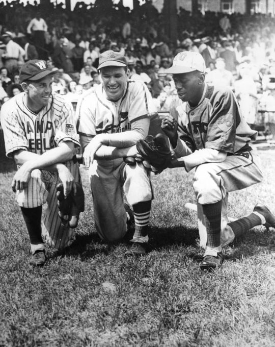 Cecil Travis (left) and Hall of Famer Dizzy Dean chat with Satchel Paige. Dean, who often squared off in barnstorming matchups against Paige, called the Negro League legend the best pitcher he'd ever seen. BL-1515-72 (National Baseball Hall of Fame Library)