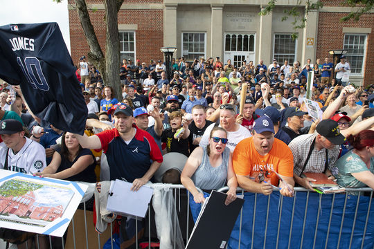 Fans cheer their heroes during the 2019 Parade of Legends in front of the Cooperstown post office. (Milo Stewart Jr./National Baseball Hall of Fame and Museum)
