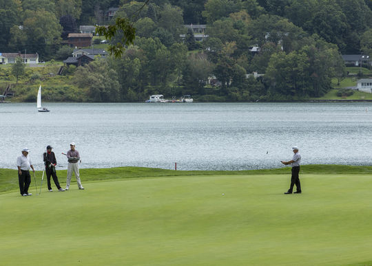 Golfers enjoy the pristine surroundings of Otsego Lake on Thursday during Round 2 of the Otesaga Hotel Seniors Open in Cooperstown. (By Photographer Milo Stewart Jr./National Baseball Hall of Fame and Museum)